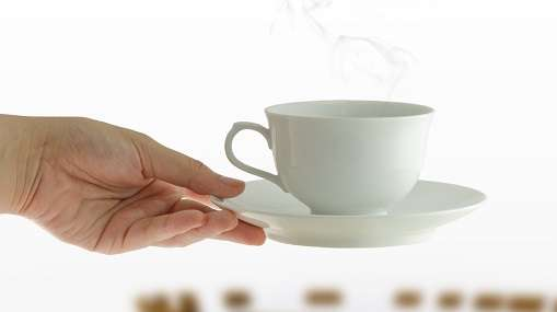 coffee-cup-in-woman-hand-on-meeting-table-background_zJIfRtHO